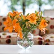 Stock Photo: Orange lilies in vase