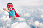 Superhero child boy flying — Stock Photo