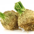 Fresh celery roots with some foliage — Stock Photo