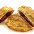 Delicious puff pastry cherry turnovers and a cut one — Stock Photo #12287452