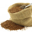 Stock Photo: Flax seed (linseed) in burlap bag with aluminum scoop