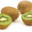 Fresh kiwi fruit and a cut one - Stock Photo