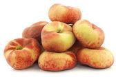 Fresh colorful flat peaches (donut peaches) — Zdjęcie stockowe
