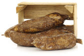 Bunch of cassava roots in a wooden crate — Stock Photo