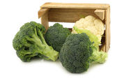 Fresh cauliflower and broccoli in a wooden crate — Stock Photo