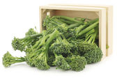 A small form of broccoli, called bimi, in a wooden box — Stock Photo