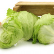 Fresh iceberg lettuce in a wooden crate — Stock Photo #51391187