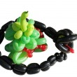 Black snake and New Year tree — Stock Photo
