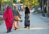 Muslim women in colorful dresses, Zanzibar — Stock Photo