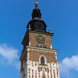 Town hall tower on main market square in cracow in poland on blue sky background — Stock Photo