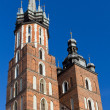 Two towers of St. Mary's Basilica on main market sguare in cracow in poland on blue sky background — Stock Photo #28548543