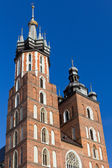 Two towers of St. Mary's Basilica on main market sguare in cracow in poland on blue sky background — Stock Photo