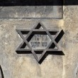 Symbol of jewish star of david on the front on old building in kazimierz-district of krakow in poland — Stock Photo