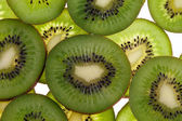 Slices of fresh green fruit kiwi isolated on white background — Stock Photo