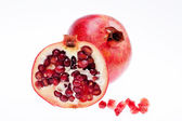 Sectioned pomegranate isolated on white background — Stock Photo