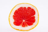 Sectioned fruit of red grapefruit isolated on white background — Stock Photo