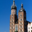 Two towers of St. Mary's Basilica on main  market sguare  in cracow in poland on blue sky background — Stock Photo #44622705