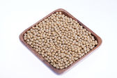 Bowl of soybeans isolated on white background — Stock Photo