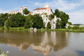 The Benedictine Abbey in Tyniec with wisla river on blue sky background — Stock Photo