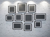 Frames on brick wall — 图库照片