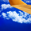 Stockfoto: Flying in high sky - Airplane wing and blue sky