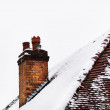 Chimney and rooftop in snowy conditions — Stock Photo