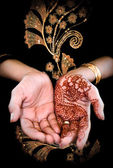 Mehendi, henna on bride's hand - Color — Stock Photo