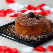 Romantic chocolate walnut cake with slice on the side — Stock Photo