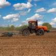 Tractor in the field - Stock Photo
