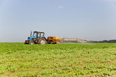 Tractor spraying the field — Stock Photo