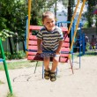 Boy on swing — Stock Photo #40223441