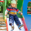 Stock Photo: Baby on slide