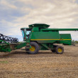 Stock Photo: Harvester on field