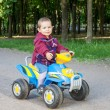 Stock Photo: Boy driving quad
