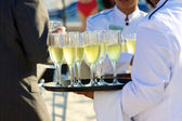 Champagne into crystal flutes — Stock Photo