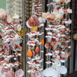 Foto Stock: Hanging wind chime made from fishing line and shells