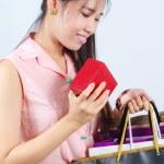 Asian women Looking shopping bag — Stock Photo