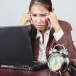 A depressed Asian businesswoman in her office — Stock Photo #19409555