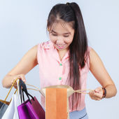Asian women Looking shopping bag — Stock Photo