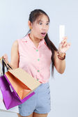 Young woman shocking after checking over the receipt in her hand — Stock Photo