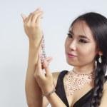 Beautiful Asian woman with pearl jewellery — Stock Photo #19412461