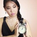 Asian woman holding a clock. — Stock Photo #19412617