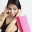 Shopping woman talking on the phone and holding bag — Stock Photo #19413647