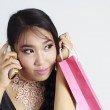 Shopping woman talking on the phone and holding bag — Stock Photo #19413939