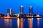 Cargo ship in the harbor at sunset. Chao Phraya River, Bangkok. — Stock Photo