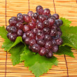 Red grape and leaf with harvest was new. — Stock Photo #23513631