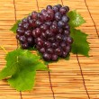 Red grape and leaf with harvest was new. — Stock Photo #23513687
