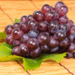 Red grape and leaf with harvest was new. — Stock Photo #23513851