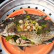 Fresh fish with oriental ingredients ready for steaming. — Stock Photo