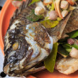 Stock Photo: Fresh fish with oriental ingredients ready for steaming.